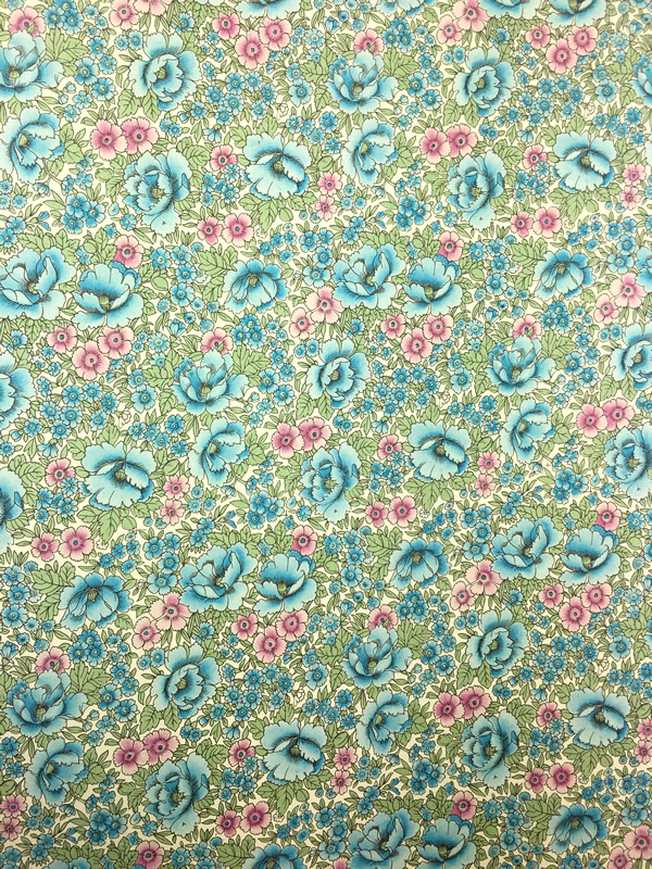 Wrapping paper from Florence in Italy with an intricate, aqua, floral pattern. Perfect for wrapping gifts or crafts.