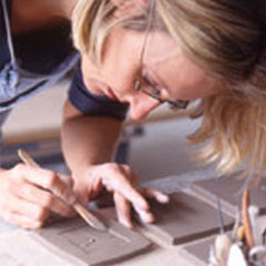 Sally hand making tiles