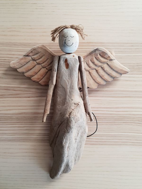 Wooden bali angels craftsmen handmade organic christmas sally bourne interiors london