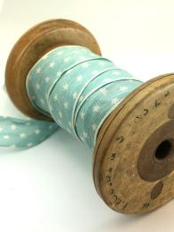 A soft blue ribbon with little white stars, 25mm wide