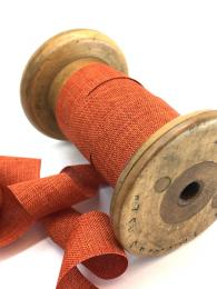 An orange linen look ribbon. 22mm wide. perfect for wrapping gifts and sewing projects.