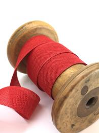 A red linen look ribbon, 22mm wide, for wrapping gifts or sewing projects