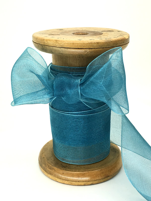 A sheer, teal, organza ribbon
