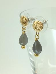 A pair of stud, drop earrings, made from gold plated brass, featuring a faceted moonstone gemstone.
