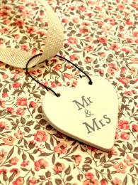 A small, wooden heart tag with the words 'Mr and Mrs' perfect for tying onto gifts or cards
